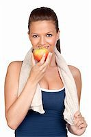sweaty woman - Gymnastics girl with a towel eating apple isolated on white background Stock Photo - Royalty-Freenull, Code: 400-04686182