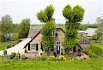 Traditional Dutch farm house alongside the dike of the river Lek  Stock Photo - Royalty-Free, Artist: erikdegraaf                   , Code: 400-04689780