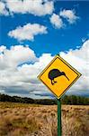 Kiwi crossing road sign against cloudy sky at New Zealand Stock Photo - Royalty-Free, Artist: naumoid                       , Code: 400-04695951