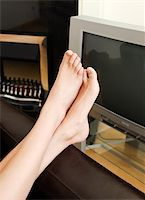 stocking feet - Close-up of woman's foot in a living-room at home Stock Photo - Royalty-Freenull, Code: 400-04702082