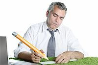 businessman senior sign bank check funny humor gesture big pencil on green grass Stock Photo - Royalty-Freenull, Code: 400-04703894