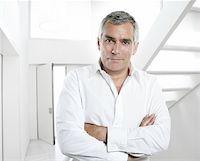 senior expertise gray hair businessman posing interior white modern office Stock Photo - Royalty-Freenull, Code: 400-04703898