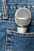 Blue jeans pocket with microphone Stock Photo - Royalty-Freenull, Code: 400-04705979