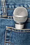Blue jeans pocket with microphone Stock Photo - Royalty-Free, Artist: naumoid                       , Code: 400-04705979