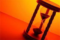 sand clock - hourglass in orange light Stock Photo - Royalty-Freenull, Code: 400-04708296
