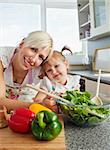 Smiling mother and daughter preparing a salad in kitchen Stock Photo - Royalty-Free, Artist: 4774344sean                   , Code: 400-04709926