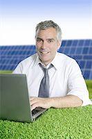 senior businessman working green grass desk solar plates Stock Photo - Royalty-Freenull, Code: 400-04712106