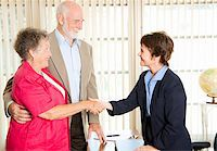 Senior couple meets with a friendly financial adviser. Stock Photo - Royalty-Freenull, Code: 400-04724921