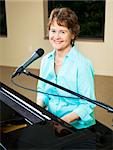 Pretty, mature piano player and singer smiles at the camera. Stock Photo - Royalty-Free, Artist: lisafx                        , Code: 400-04728286