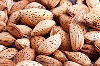 fat man balls - Almonds on white background Stock Photo - Royalty-Freenull, Code: 400-04730279