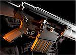 Assault weapon on a black vest with an orange gel from the side Stock Photo - Royalty-Free, Artist: gsagi                         , Code: 400-04733109