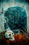 closeup of a grave in a cemetery for Halloween