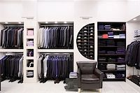 Luxury men's clothes and accessories in modern shop interior Stock Photo