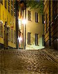 Narrow street at night in the old town (Gamla Stan) of Stockholm, sweden Stock Photo - Royalty-Free, Artist: PinkBadger                    , Code: 400-04740834