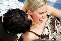 A man kissing a woman on the neck and a woman smiling Stock Photo - Royalty-Freenull, Code: 400-04741890