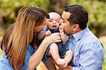 Happy Mixed Race Parents Playing with Their Giggling Son. Stock Photo - Royalty-Free, Artist: Feverpitched, Code: 400-04743689