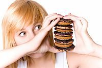 closeup portrait of young woman with chocolate chip cookies Stock Photo - Royalty-Freenull, Code: 400-04750101