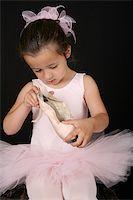 Cute little brunette girl in a pink ballet costume Stock Photo - Royalty-Freenull, Code: 400-04750135