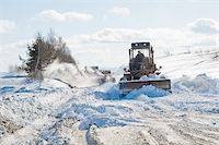 snow plow truck - Snowplow removing snow from intercity road from snow blizzard Stock Photo - Royalty-Freenull, Code: 400-04751000