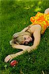 The girl on the lawn (grass) in the summer in the park Stock Photo - Royalty-Free, Artist: APavlov                       , Code: 400-04751951