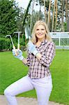 Pretty gardener woman with gardening tools outdoors. greenhouse on the background Stock Photo - Royalty-Free, Artist: smartfoto                     , Code: 400-04760444