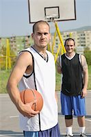 basketball player team group  posing on streetbal court at the city on early morning Stock Photo - Royalty-Free, Artist: dotshock, Code: 400-04779681