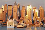 New York City Manhattan skyline panorama at sunset with skyscrapers and sunshine reflection over Hudson river. Stock Photo - Royalty-Free, Artist: rabbit75_cre                  , Code: 400-04782243