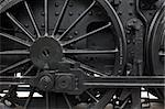 Closeup of vintage steam engine's black, iron wheel