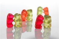 sweet gummy bears dancing on a party on white background Stock Photo - Royalty-Freenull, Code: 400-04789961