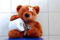 toy teddy bear with paper in the bathroom on toilet Stock Photo - Royalty-Freenull, Code: 400-04796222