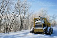 snow plow truck - Tractor covered with snow sits idle Stock Photo - Royalty-Freenull, Code: 400-04811057