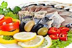 close up sliced fish with vegetables isolated