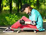 Beautiful teenage girl with skateboard in the green park Stock Photo - Royalty-Free, Artist: fotostok_pdv                  , Code: 400-04821321