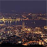 City night scene of harbor and tower in Penang, Malaysia, Asia.
