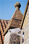 CCTV security camera mounted on top of old stone building in market square of small country town. Somerton, Somerset.