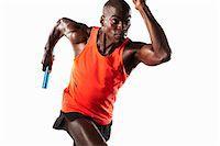 sprint - Athlete running with relay baton Stock Photo - Premium Royalty-Freenull, Code: 649-04827199