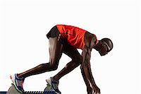 sprint - Runner crouched at starting line Stock Photo - Premium Royalty-Freenull, Code: 649-04827206
