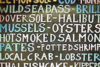 Blackboard with seafood varieties Stock Photo - Premium Royalty-Freenull, Code: 649-04827225