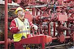 Worker operating machinery on oil rig Stock Photo - Premium Royalty-Freenull, Code: 649-04827708