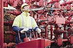 Worker operating machinery on oil rig Stock Photo - Premium Royalty-Freenull, Code: 649-04827709
