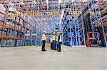 Workers talking in warehouse Stock Photo - Premium Royalty-Freenull, Code: 649-04827779