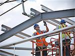 Construction workers in cherry picker Stock Photo - Premium Royalty-Free, Artist: Garry Black, Code: 649-04828555