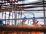 Construction workers reading blueprints Stock Photo - Premium Royalty-Free, Artist: foodanddrinkphotos, Code: 649-04828567
