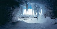 panoramic winter scene - Icicles hanging at mouth of cave Stock Photo - Premium Royalty-Freenull, Code: 649-04828976
