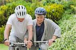 Mature couple mountain biking outside Stock Photo - Royalty-Free, Artist: 4774344sean                   , Code: 400-04830140