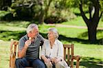 Senior couple eating an ice cream on a bench Stock Photo - Royalty-Free, Artist: 4774344sean                   , Code: 400-04830959