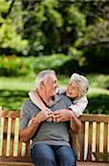 Mature couple hugging in the garden Stock Photo - Royalty-Free, Artist: 4774344sean                   , Code: 400-04830967