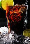 Fresh cola drink with ice and green lime on black background Stock Photo - Royalty-Free, Artist: yekophotostudio               , Code: 400-04832146
