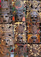 aztec mayan wooden Mexican indian mask handcrafts in rows Stock Photo - Royalty-Freenull, Code: 400-04833070