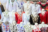 Mayan Mexico dresses embroidery shop in rows traditional clothes Stock Photo - Royalty-Freenull, Code: 400-04837560
